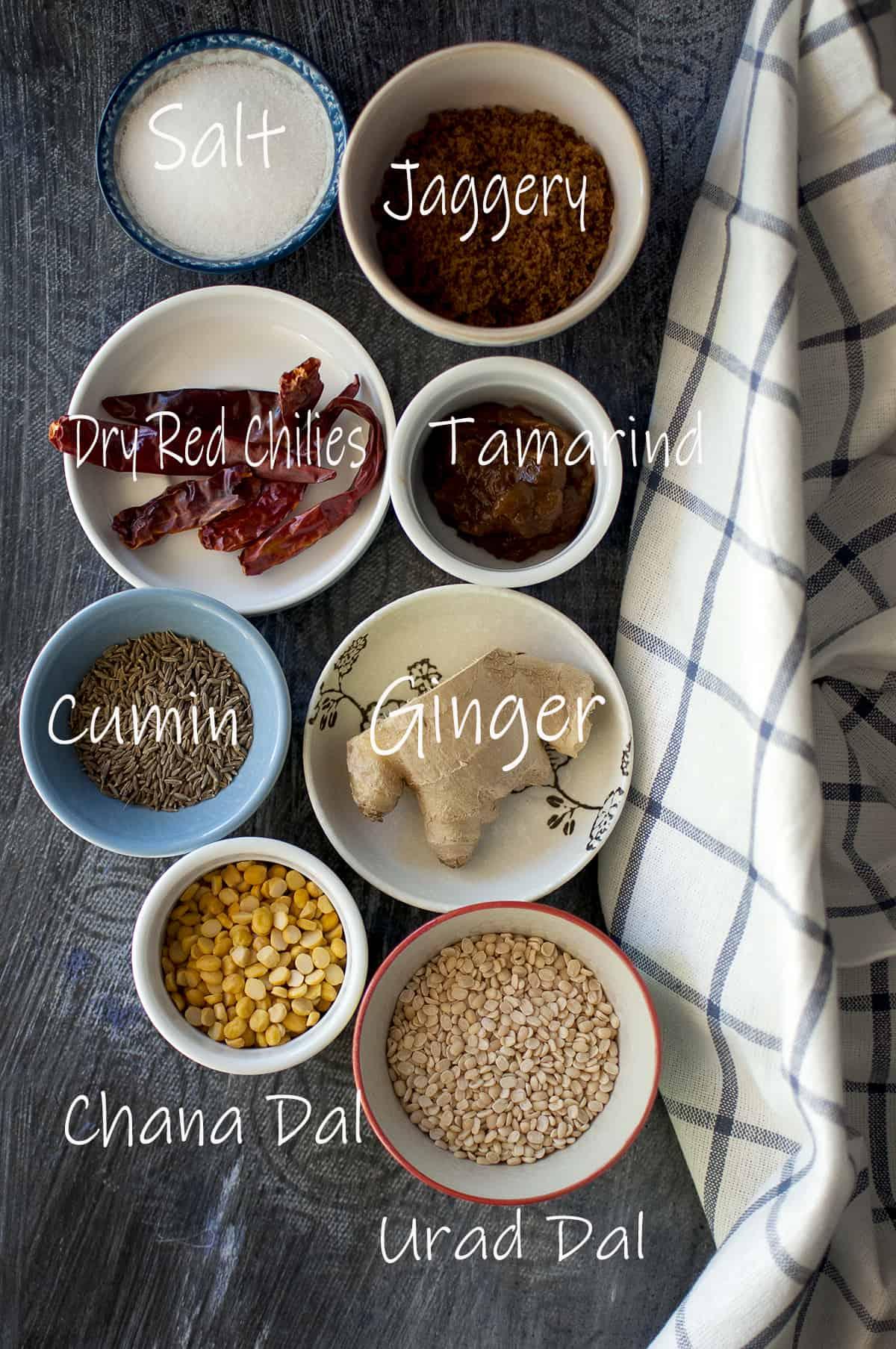 Ingredients needed to make ginger chutney - fresh ginger, urad, chana, cumin, dry red chilies, salt, jaggery & tamarind paste