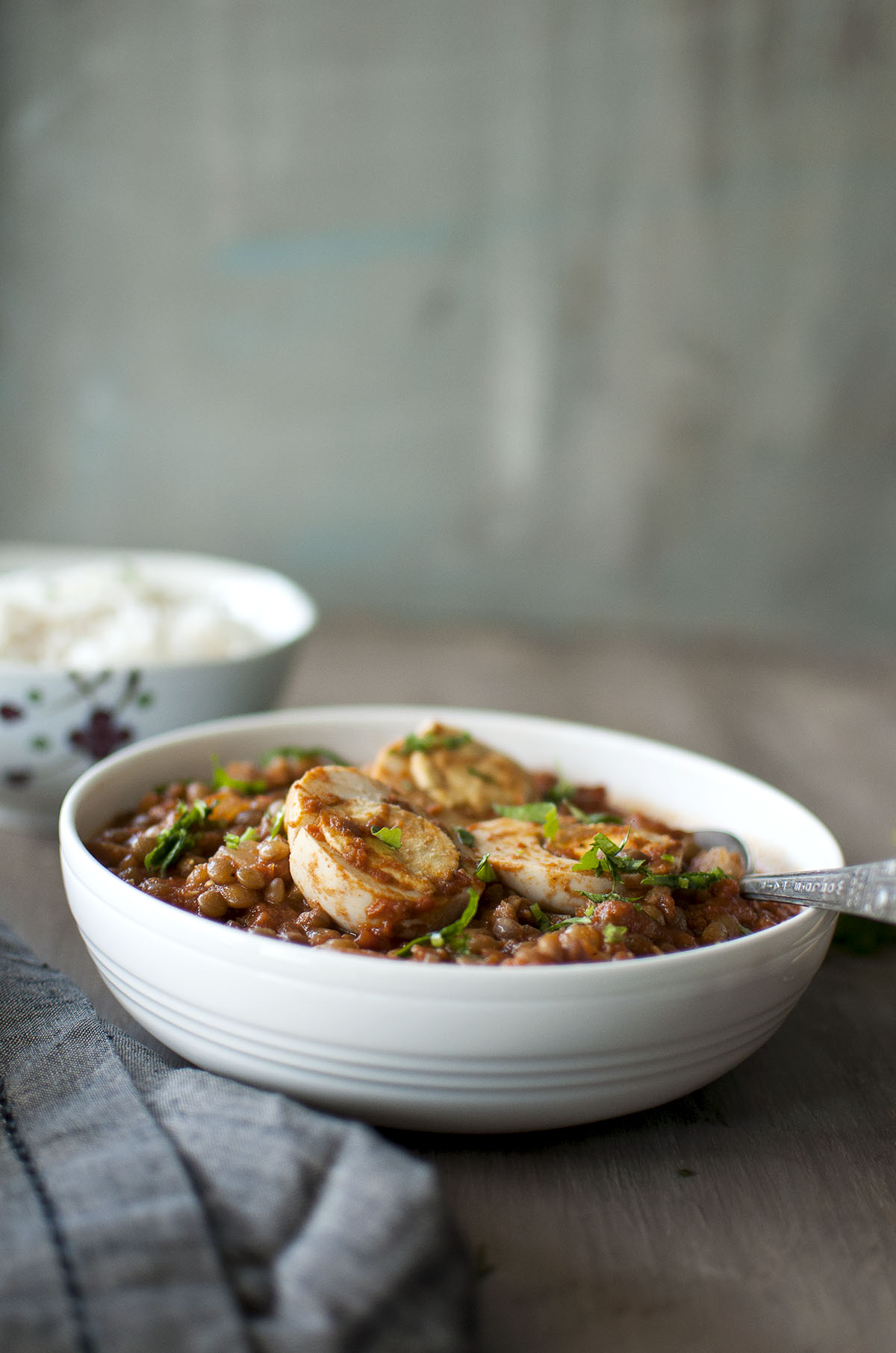 White bowl with egg and lentil curry