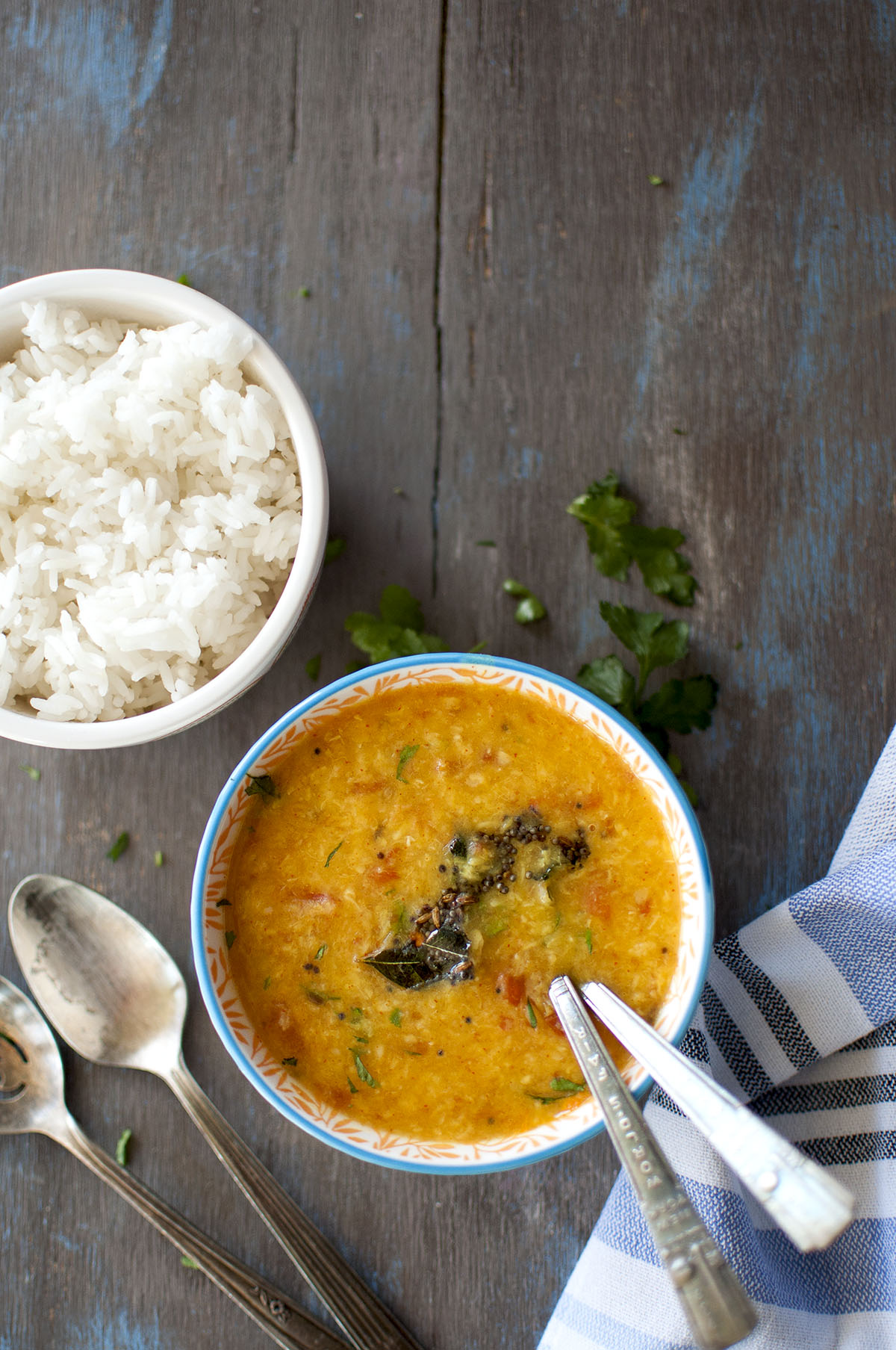 WHite bowl with tomato moong dal