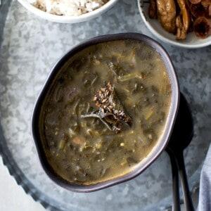 black bowl with palak pulusu