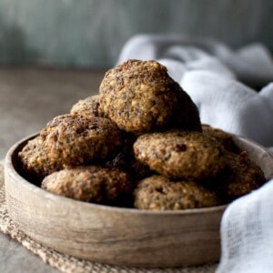Wooden bowl with a stack of mung bean fritter