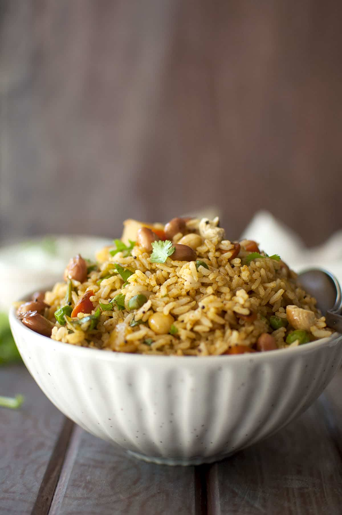 White bowl filled with mixed vegetable rice