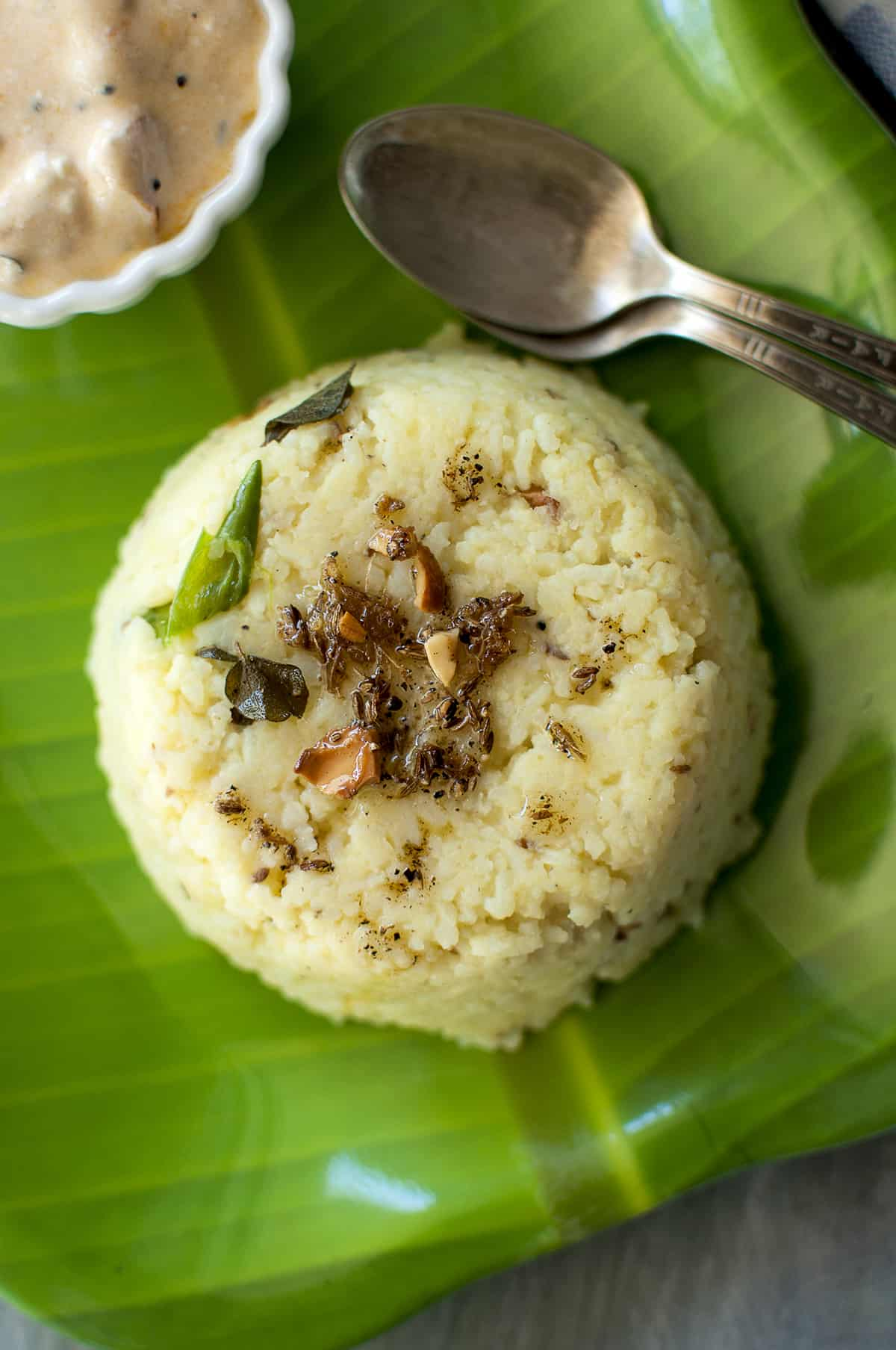 Green plate with pongal and spoons