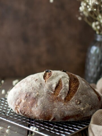 Wire rack with a boule of sourdough bread