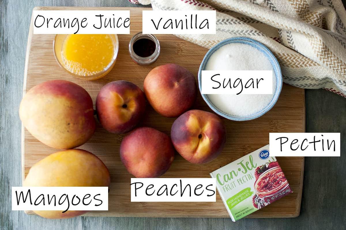 Ingredients - fresh mangoes, peaches, pectin, sugar, ground vanilla and orange juice