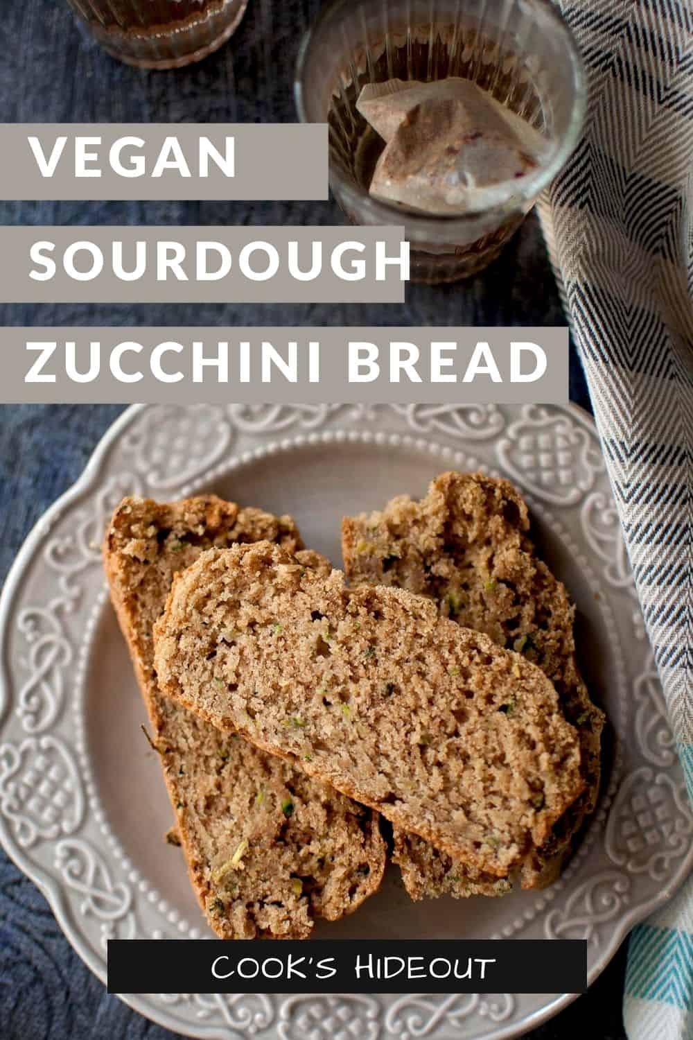 Grey plate with slices of sourdough zucchini bread