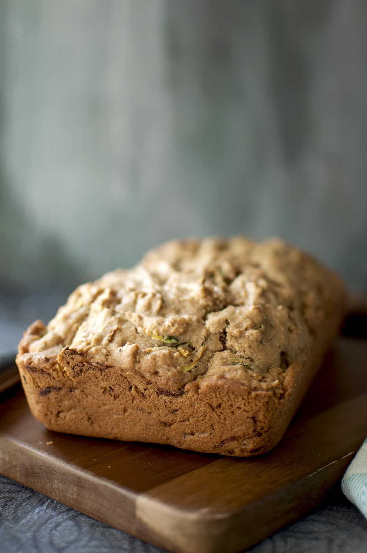 zucchini loaf placed on a chopped board