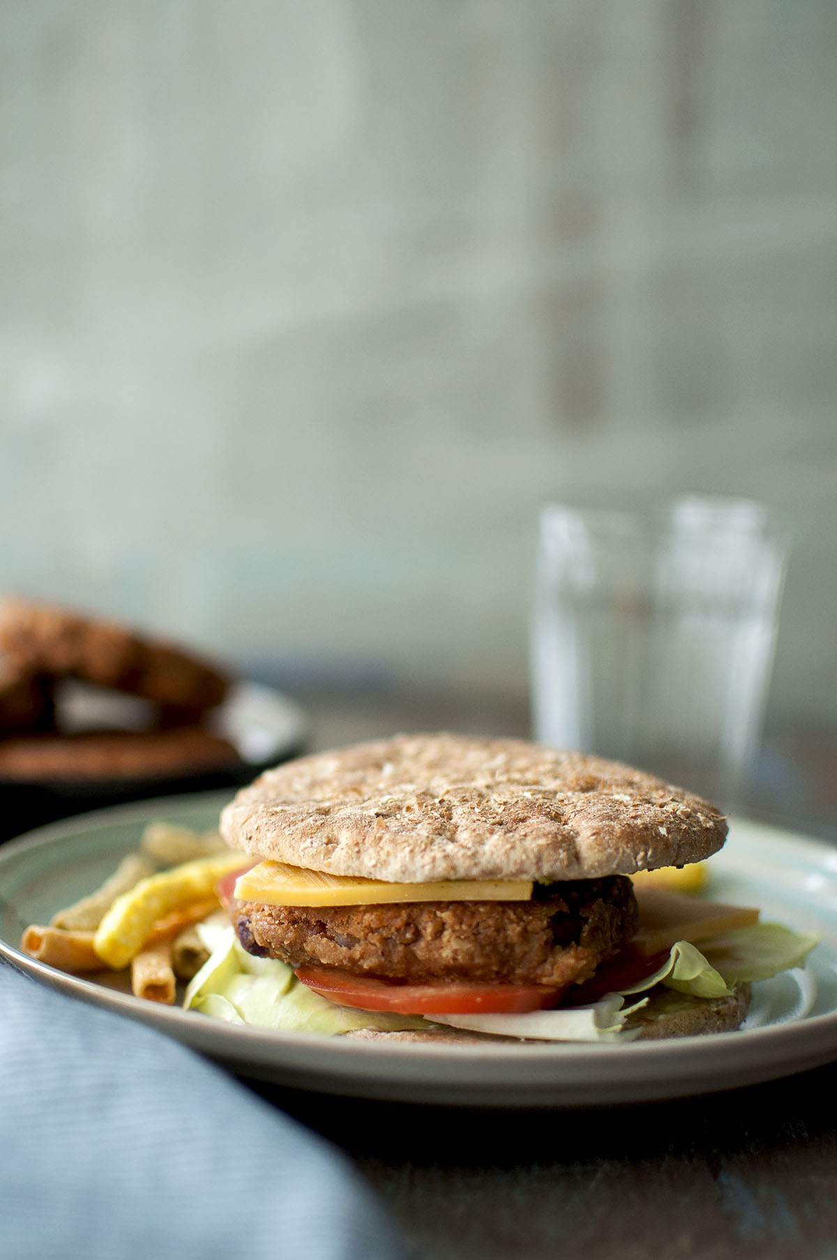 Plate with sandwich with refried bean burger