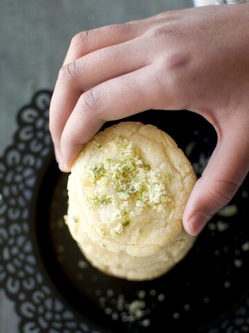 Hand holding a lime sugar cookie