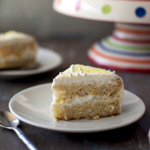 White plate with a slice of pineapple cool cake