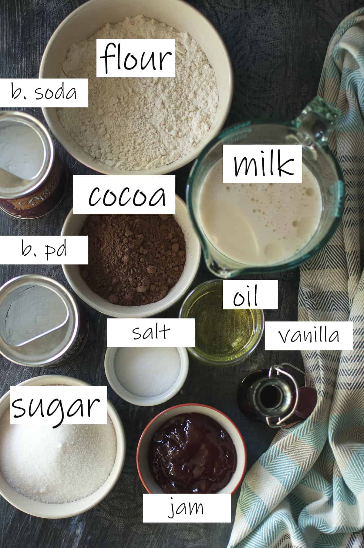 Ingredients needed to make the cake recipe placed in bowls