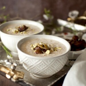 2 bowls of sheer khurma on a silver tray