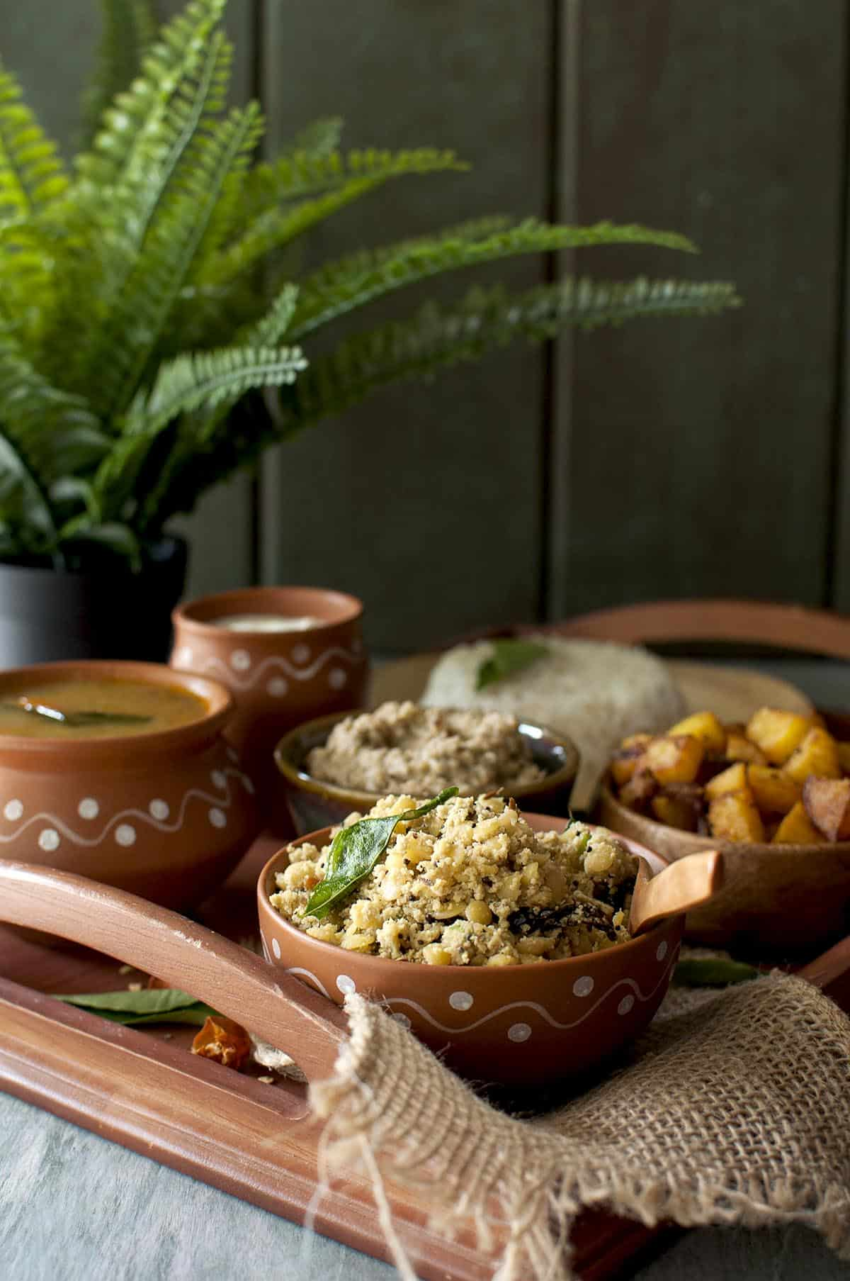 wooden tray with an Andhra style meal