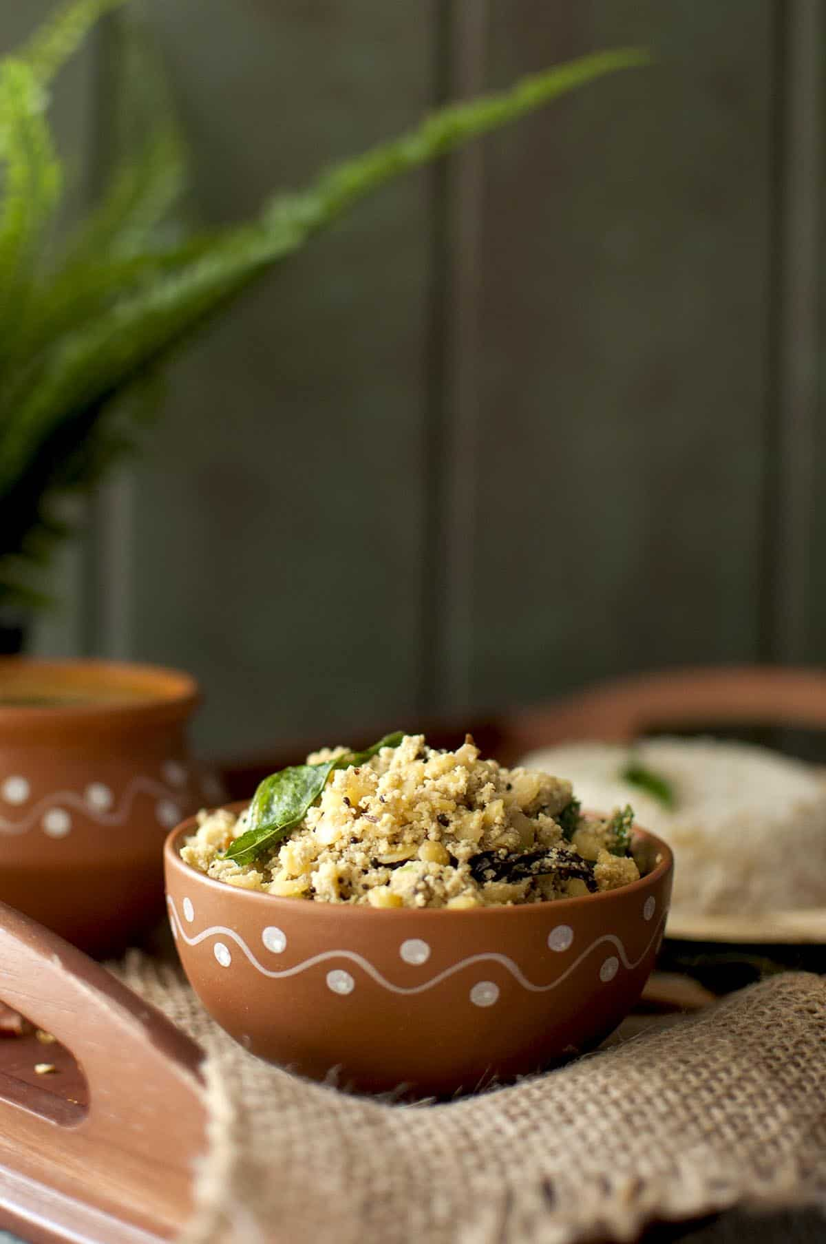 Terracotta bowl with sesame seeds lentil curry