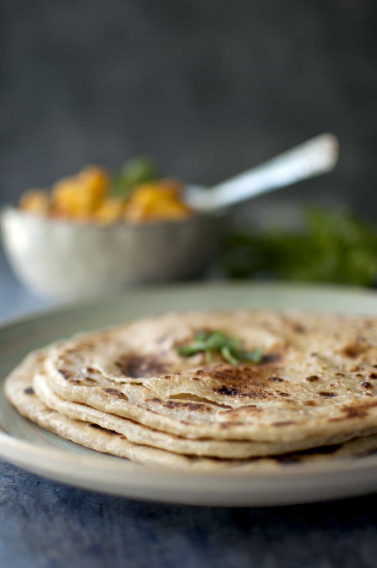 Blue plate with layered and flaky parotta