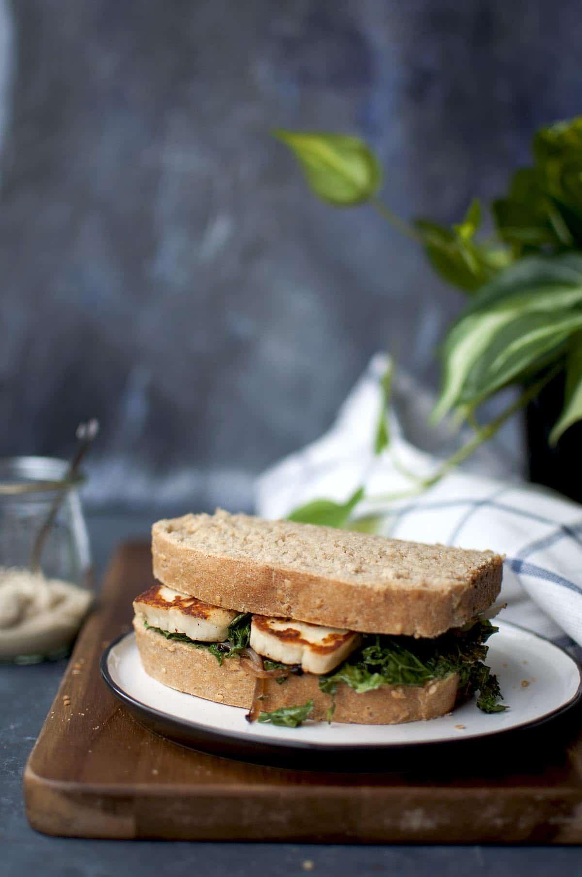 White plate with halloumi sandwich