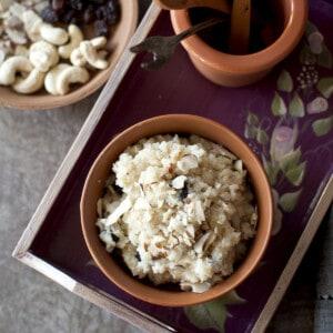 Burgundy tray with a bowl of kesaribath