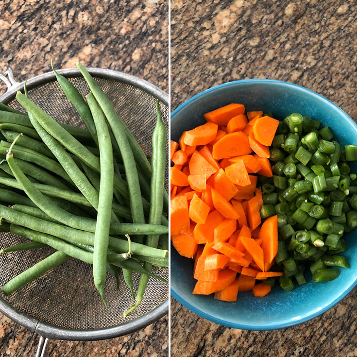 Green Beans in a sieve and chopped green beans and carrot in blue bowl