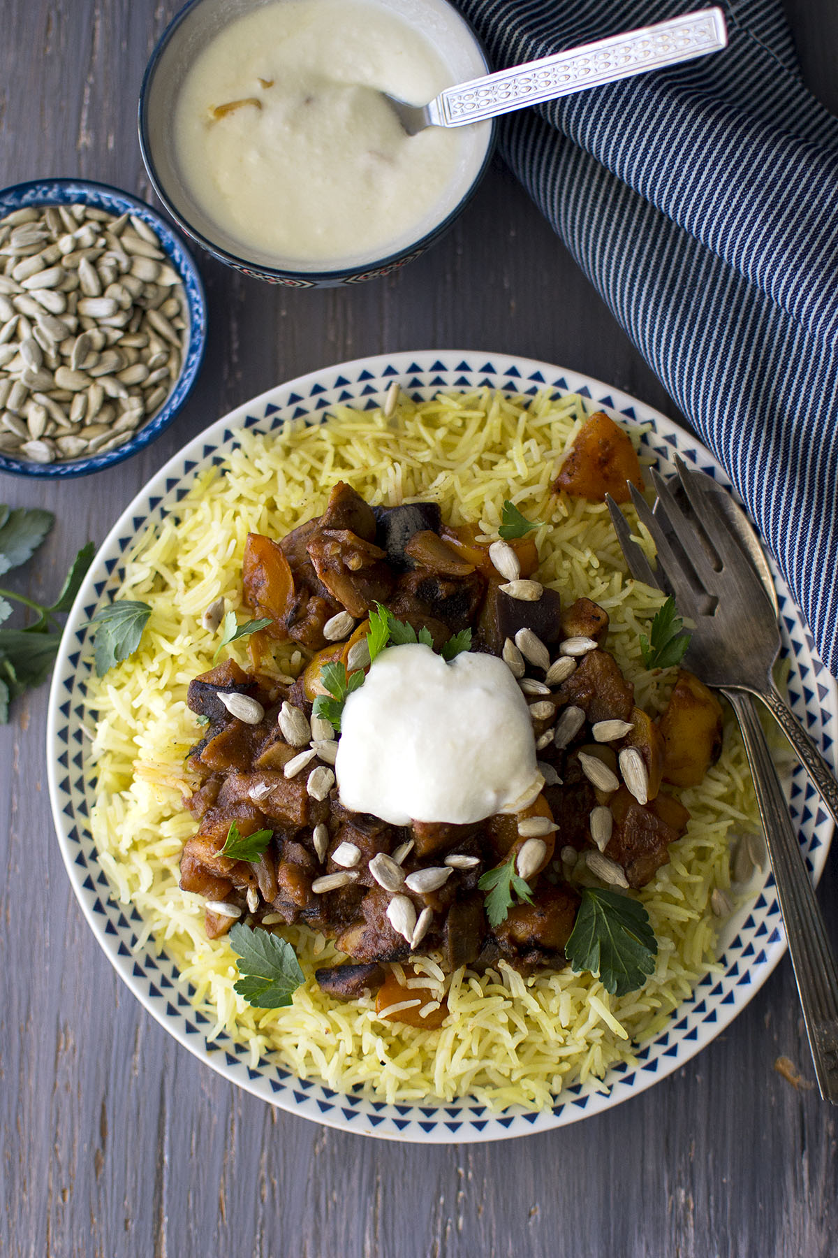 White late with Jordanian Rice Pilaf with vegetables and yogurt sauce on top