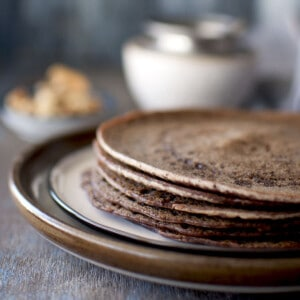 Brown plate with a stack of Sweet Ragi Dosa