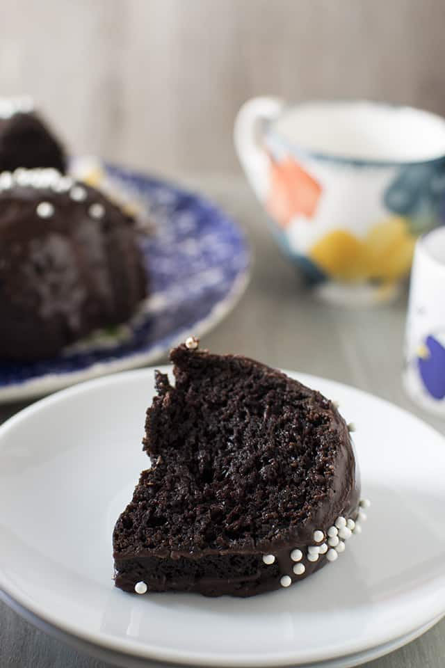 Perfect slice of moist chocolate cake on a white plate