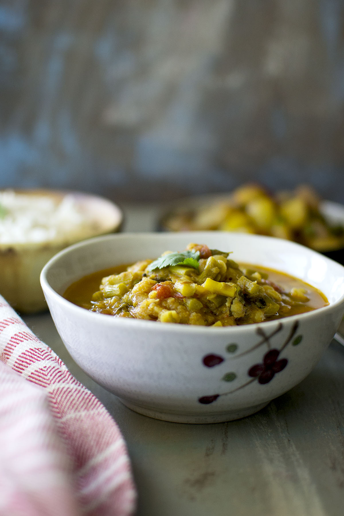 Grey bowl with asparagus lentil soup