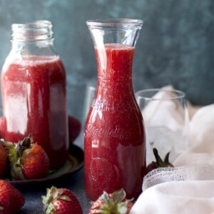 two glass jars with strawberry crush