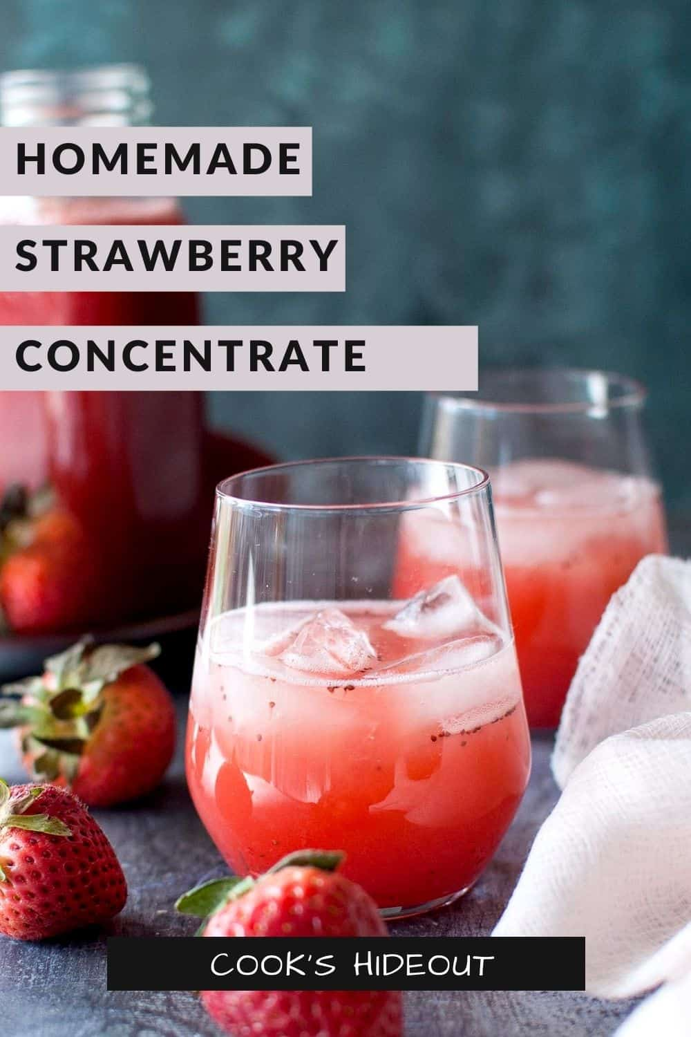 Strawberry juice in a glass with ice cubes