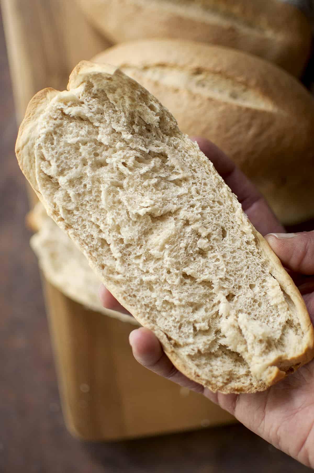 Hand holding split bread
