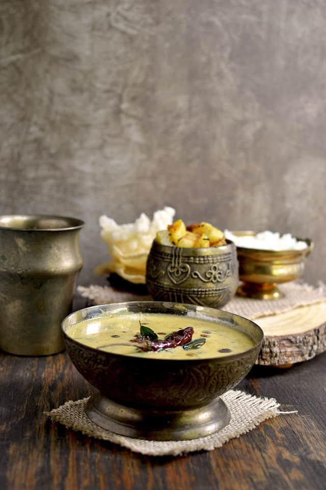 Bowl of Mor Kuzhambu with Potato Curry and Rice
