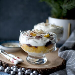 Ambrosia Salad Parfait in a glass set over a wooden board