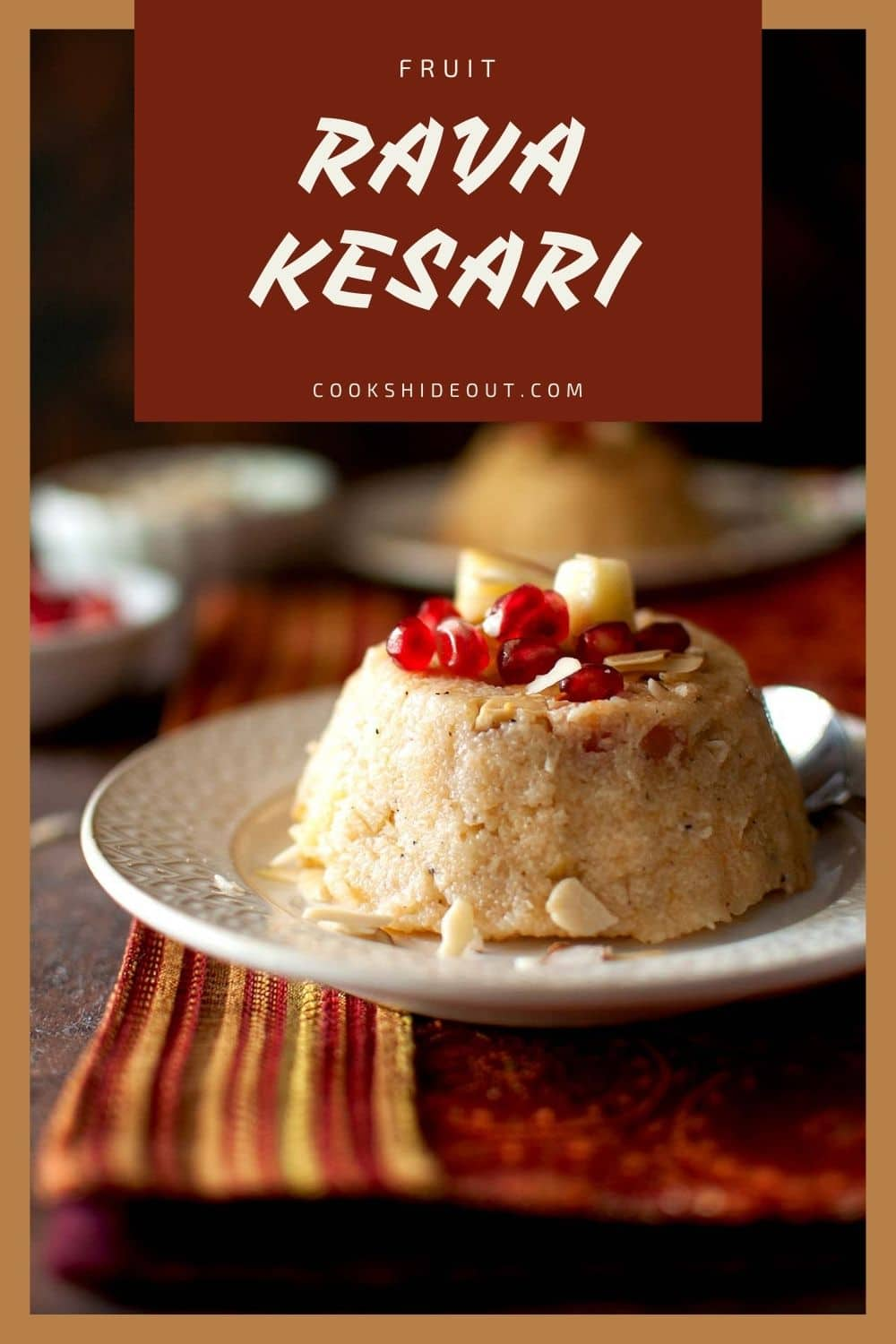 White plate with fruit kesari topped with pomegranate arils
