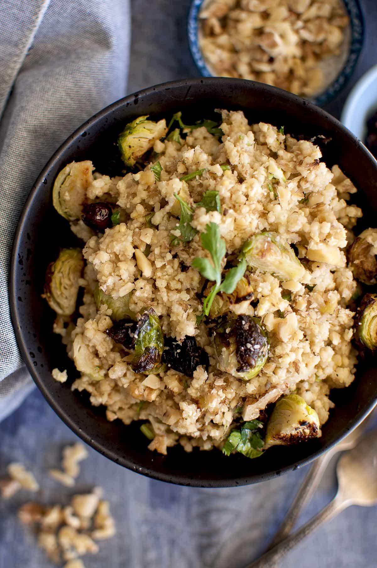 Black bowl with warm millet salad