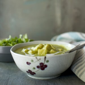 Grey printed bowl with green paneer curry