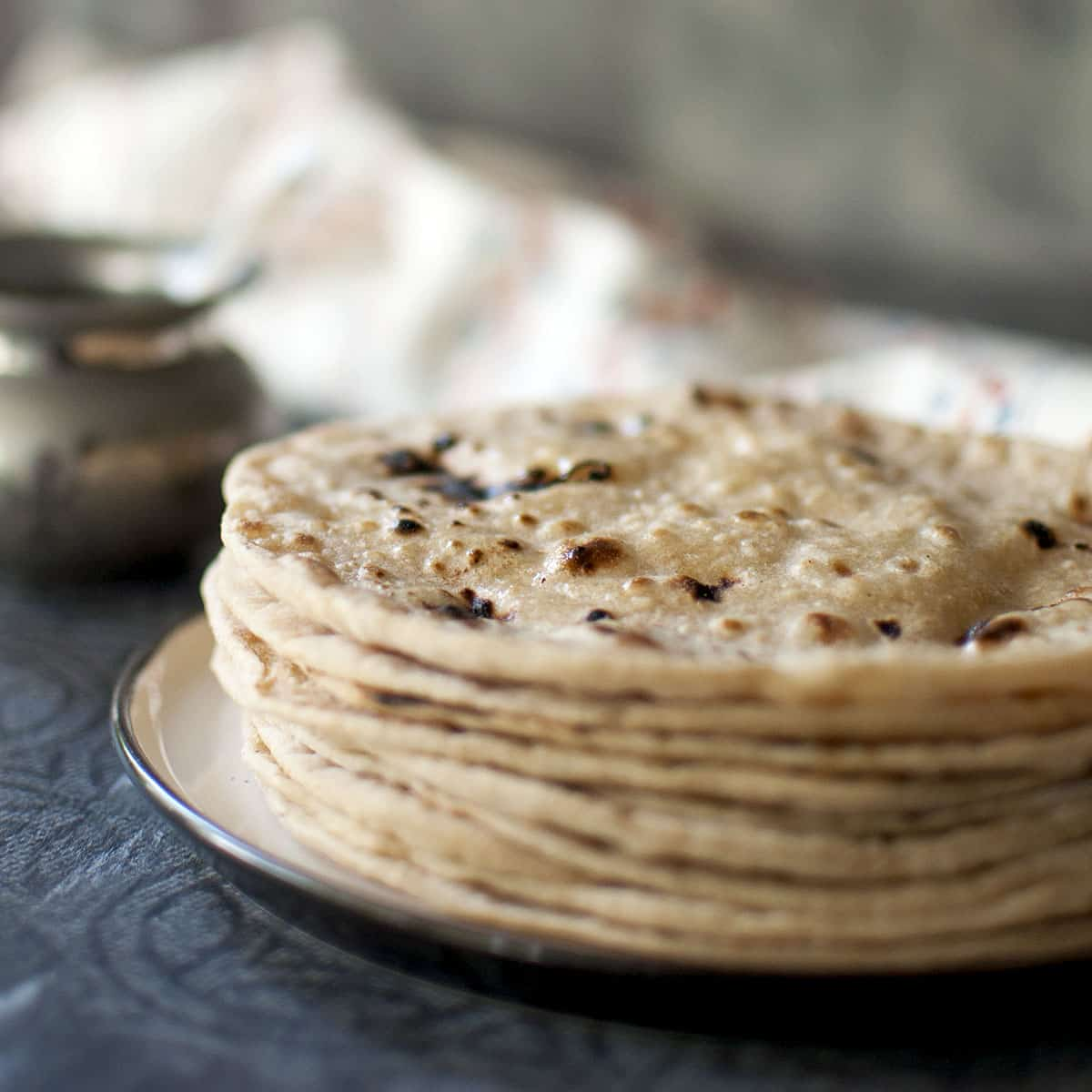 White plate with Stack of roti