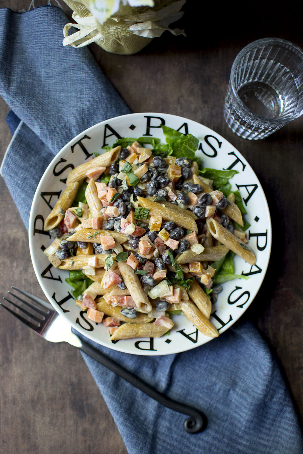 White Pasta bowl with salad and beans