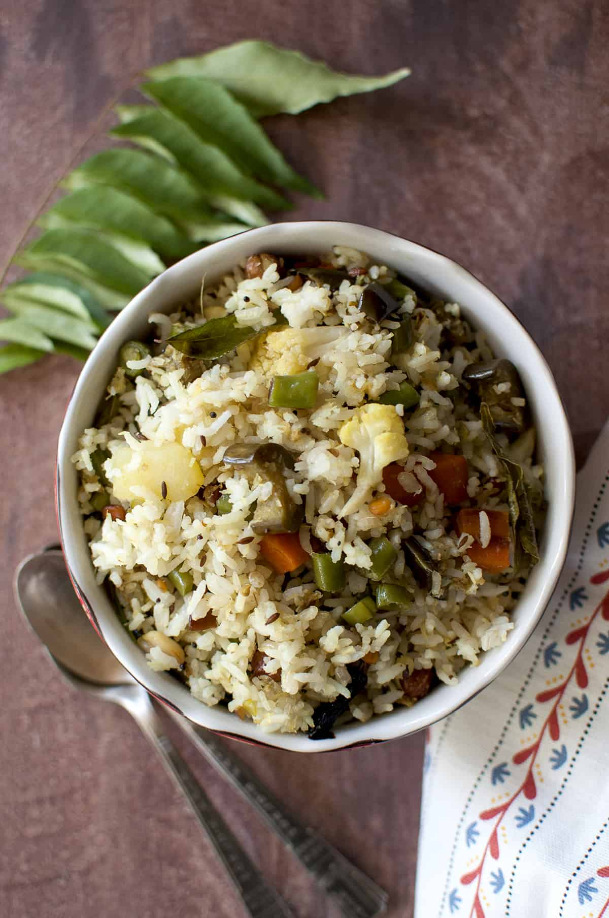 Dasara recipe - mixed vegetable rice served in white bowl