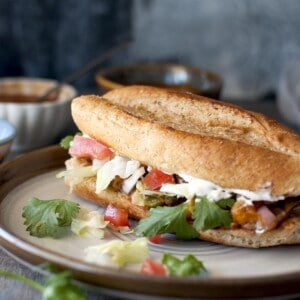 Grey plate with vegetarian torta sandwich