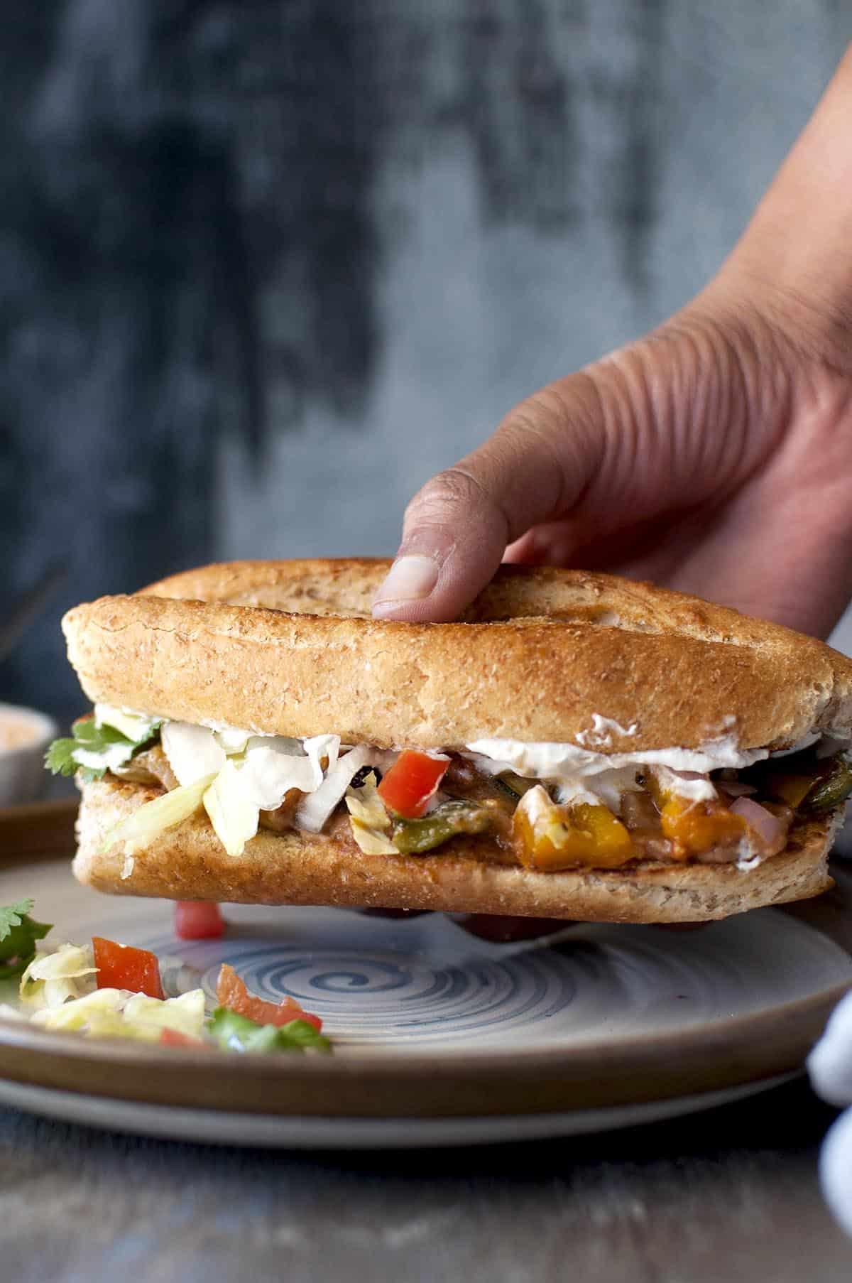 Hand holding a vegetarian torta