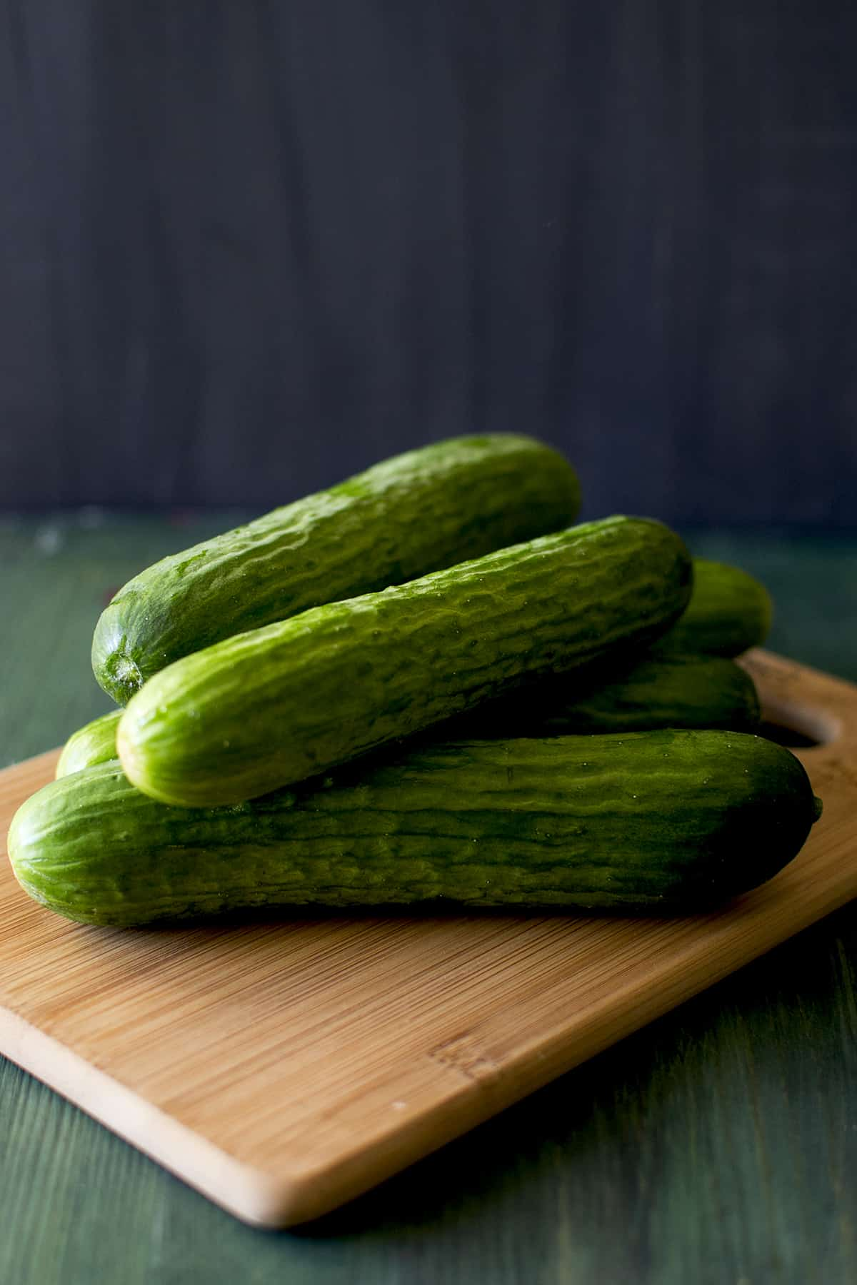chopping board with fresh Persian cukes