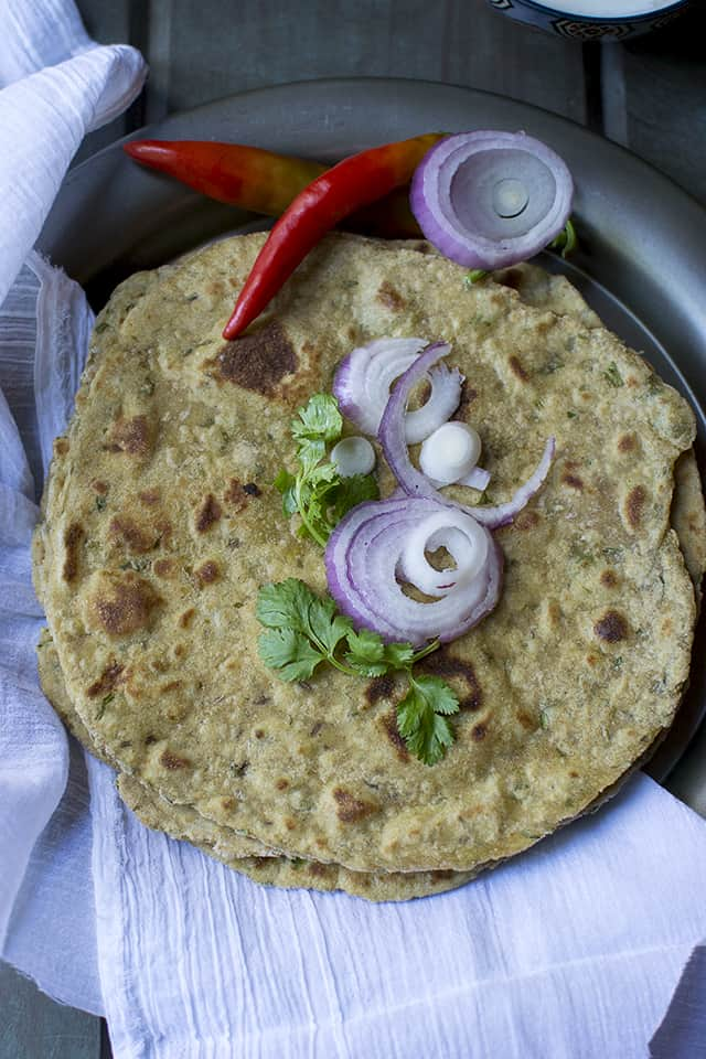 Maharashtrian flatbread served with onions and chilies