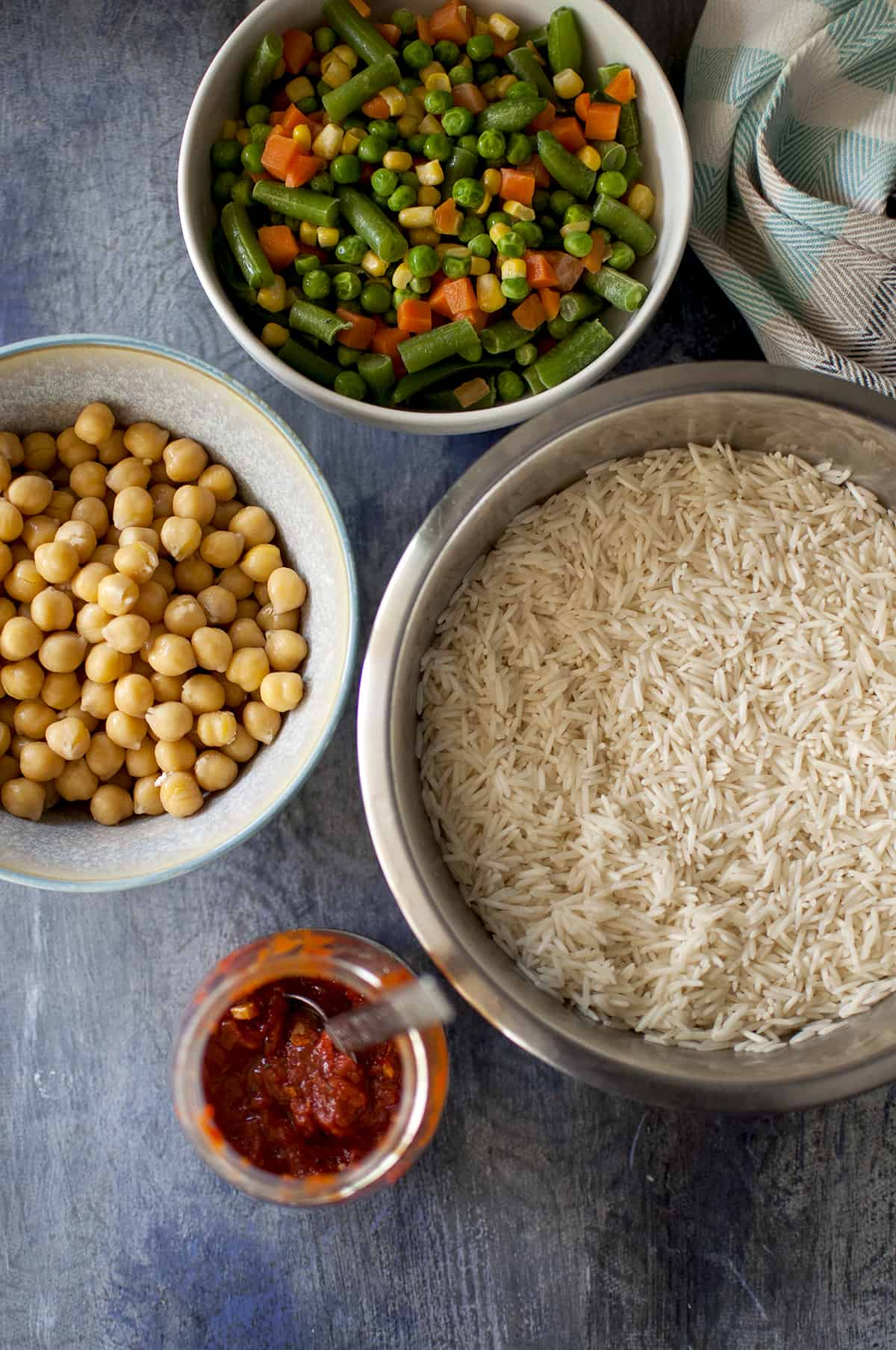 Required Ingredients for achari pulao - mixed vegetables, rice, chickpeas and chutney