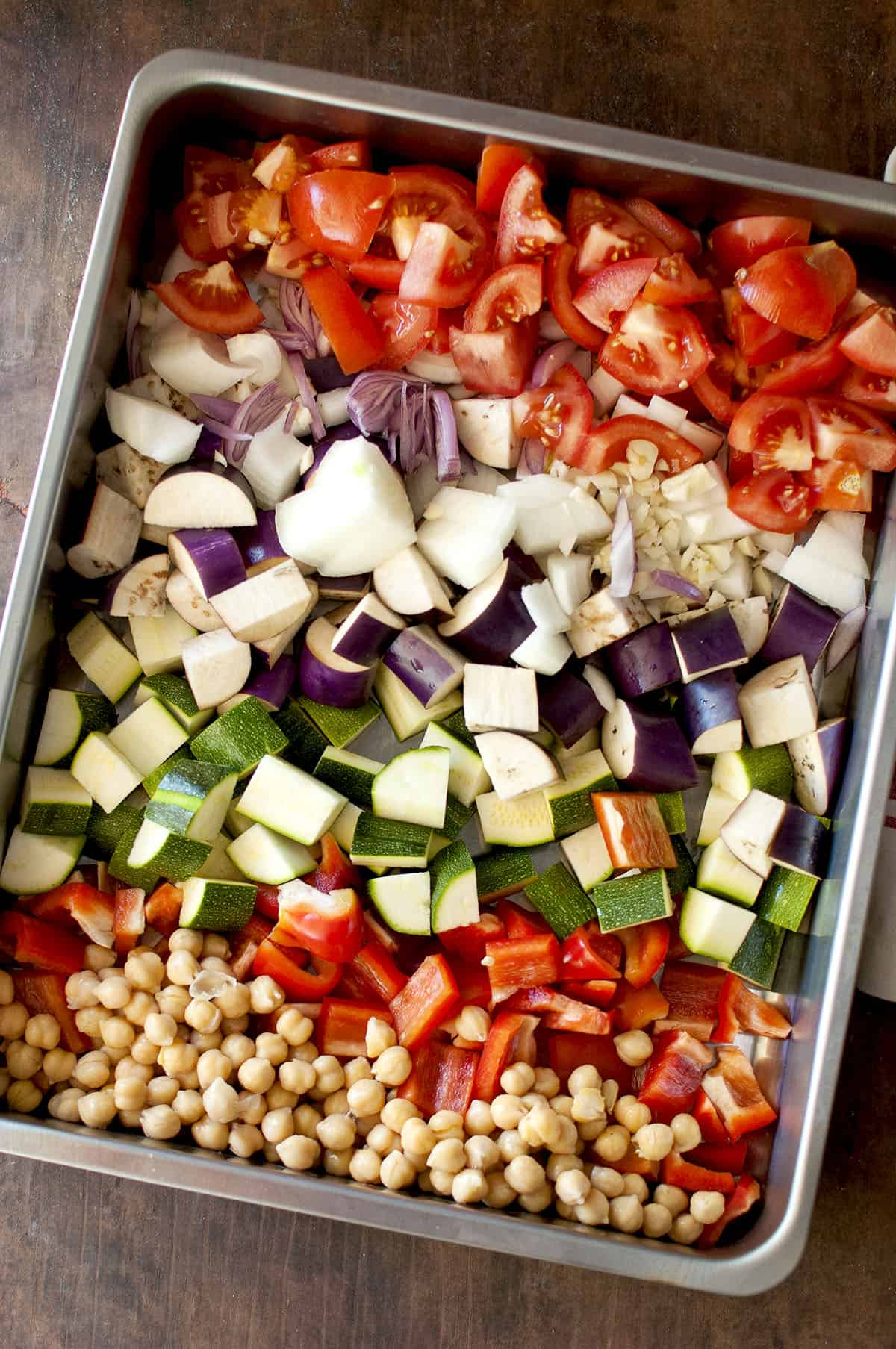 Roasting pan with chopped vegetables and chickpeas