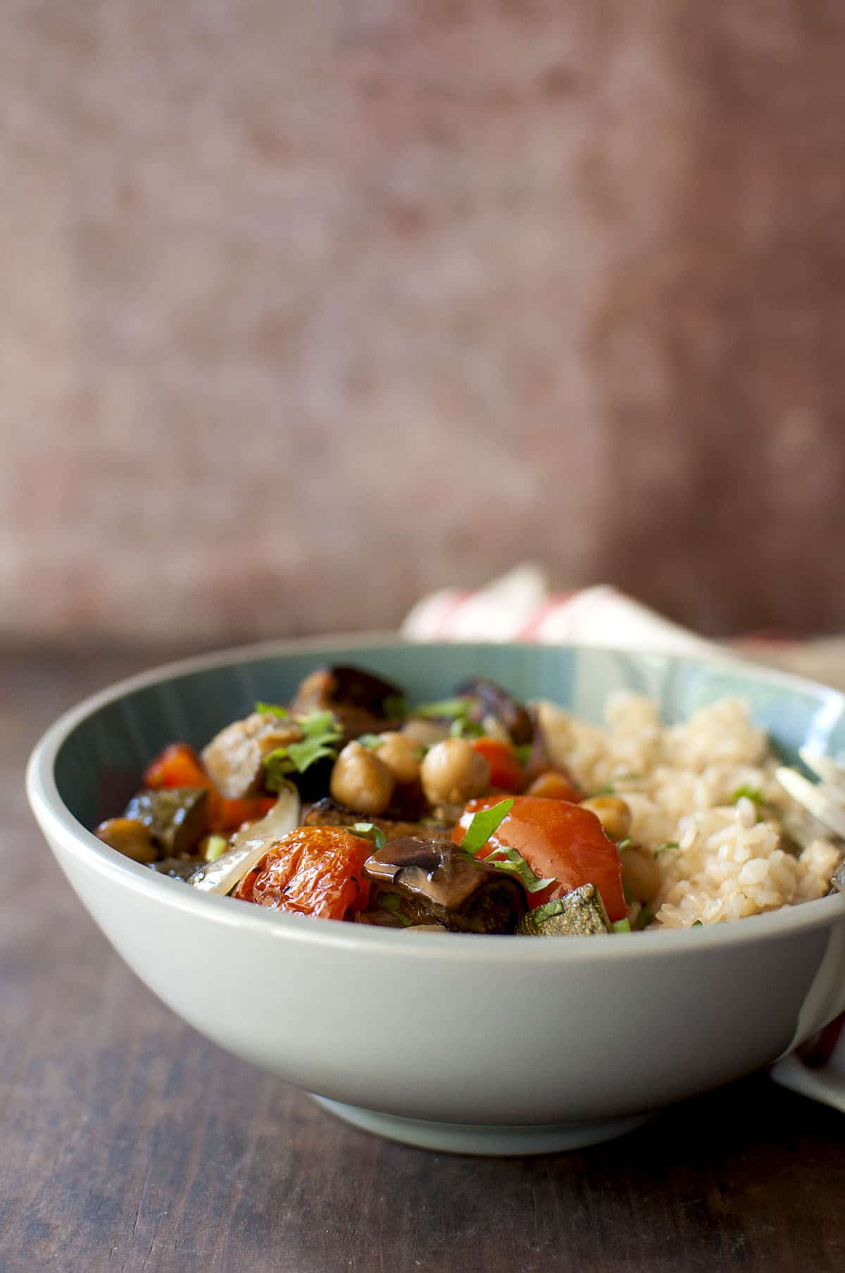 Grey bowl with brown rice and roasted vegetables