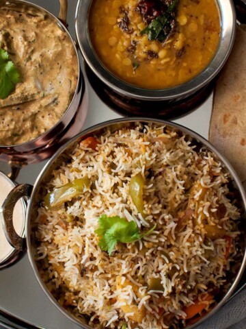 Steel plate with rice, dal, curry and roti