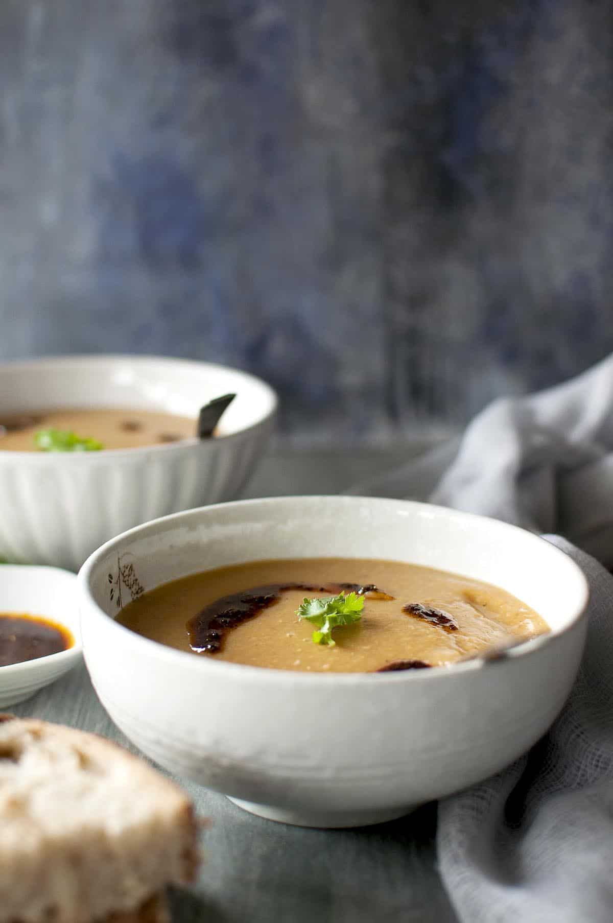 White bowl with creamy lentil soup