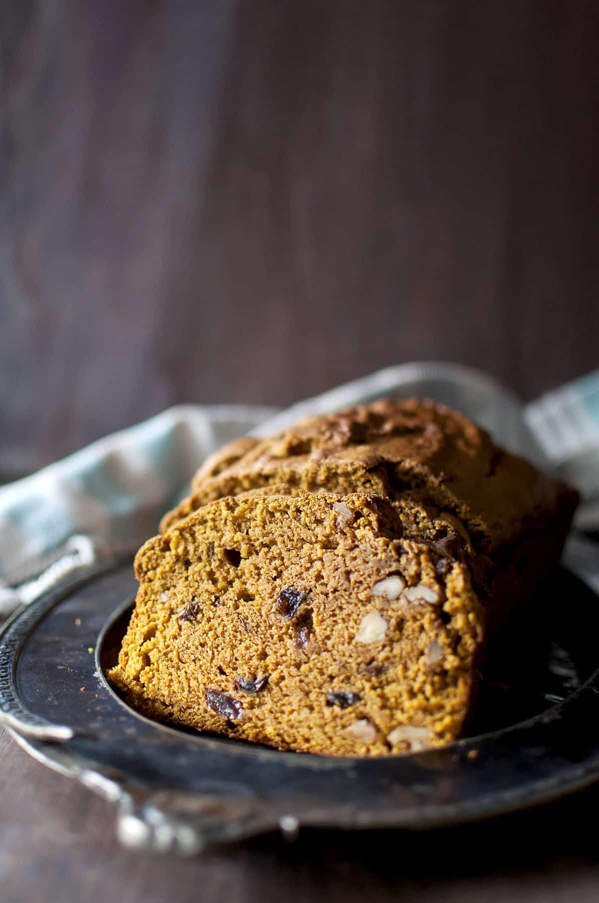 Plate with slices of raisin & walnut studded sourdough pumpkin bread