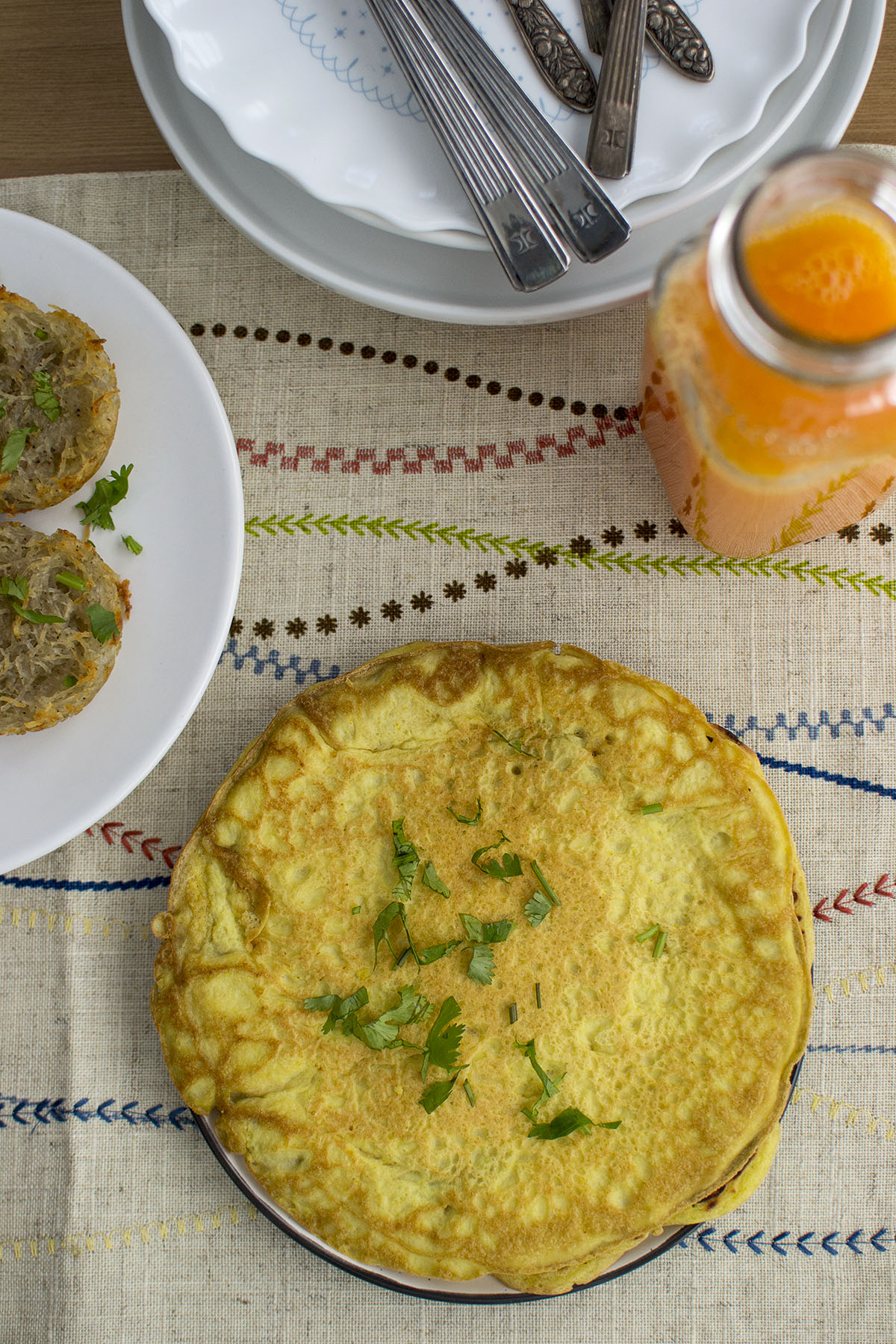 Plate with omelette with cilantro garnish