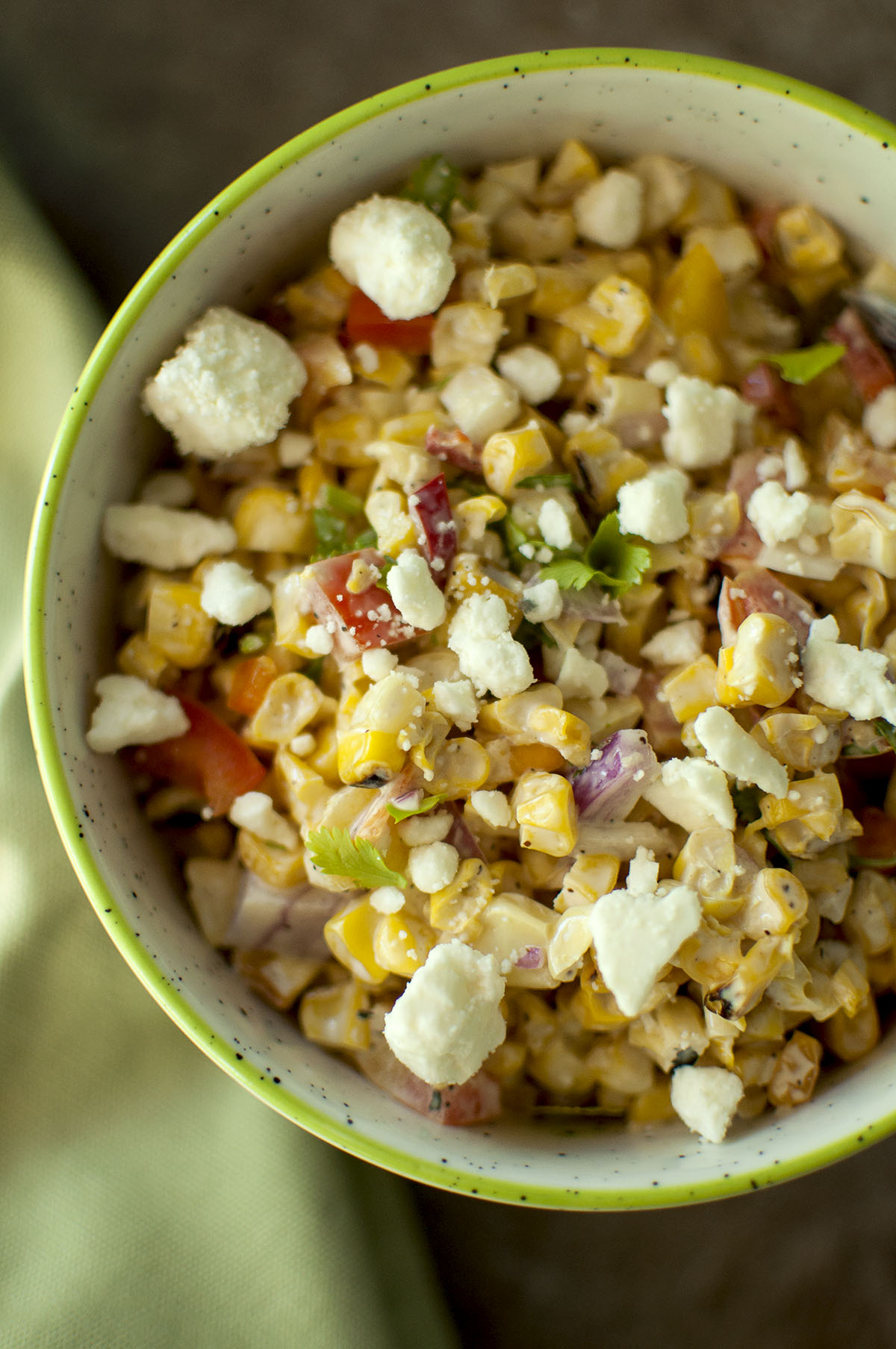 White bowl with Mexican Grilled Corn topped with cheese