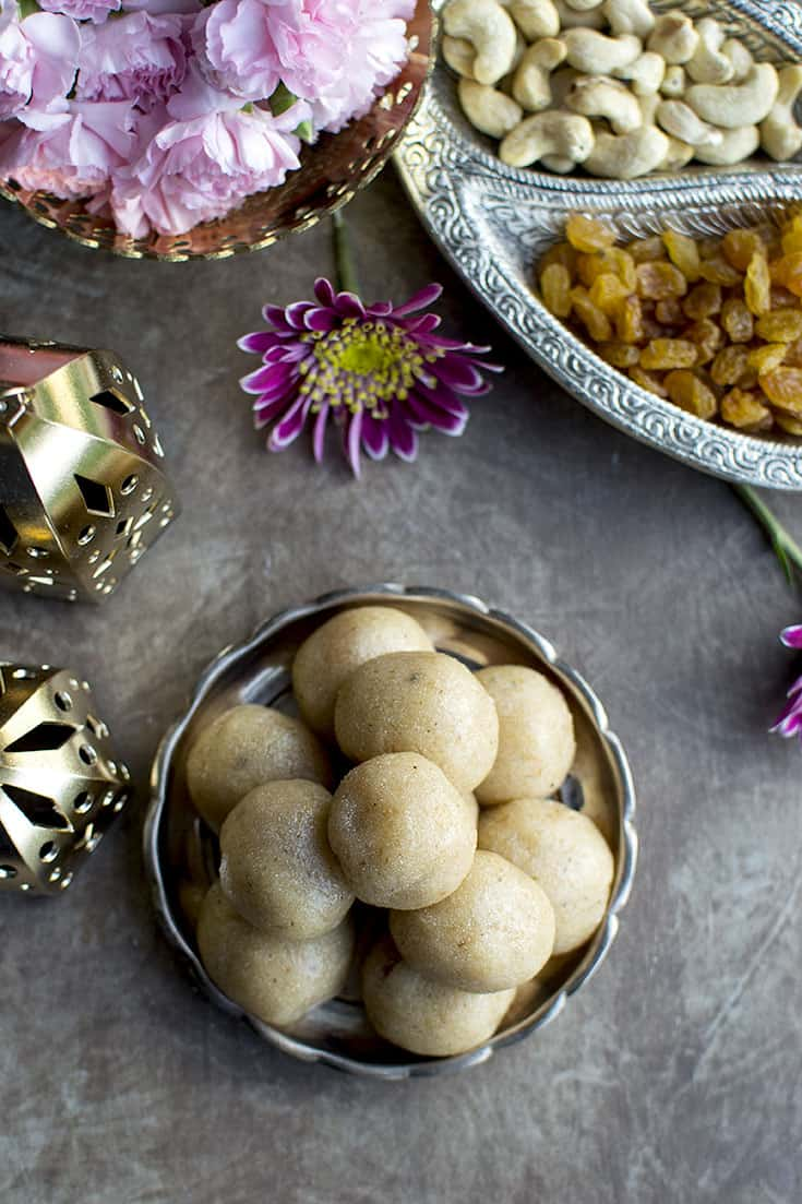 Plate with sooji laddoo and dry fruits around it
